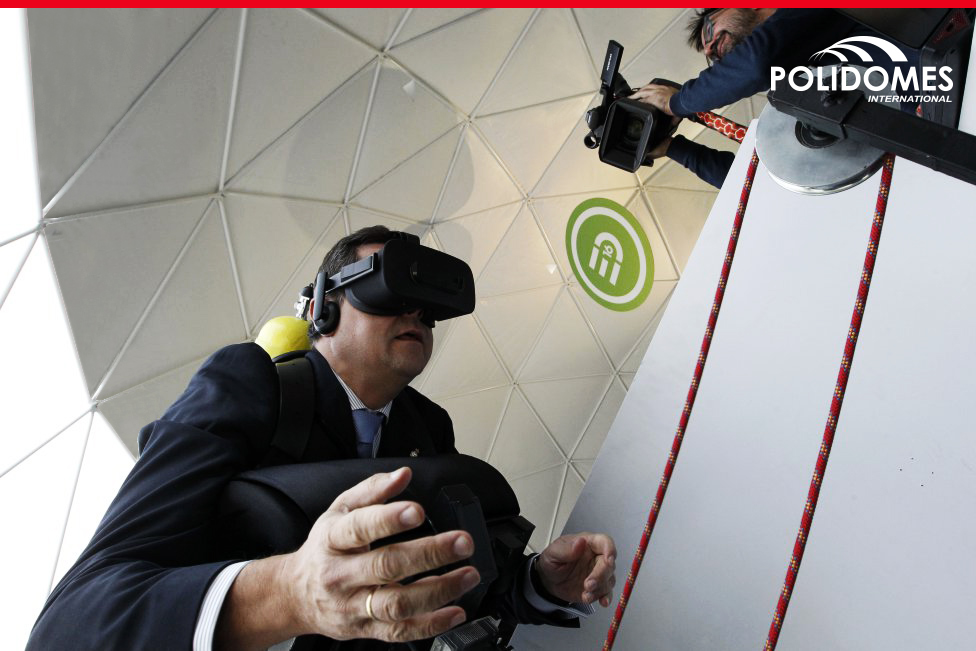 Business man testing virtual reality with 3D glasses during sporting exhibition in Polidomes geodesic tent