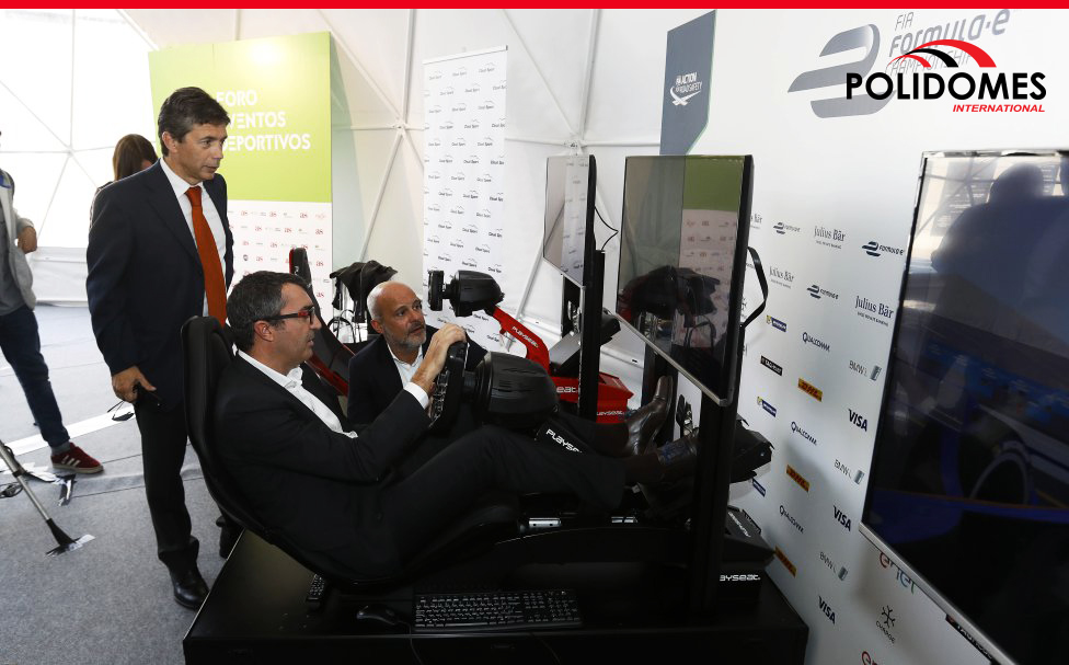Business men taking part in Gaming technologies exhibition in geodesic tent