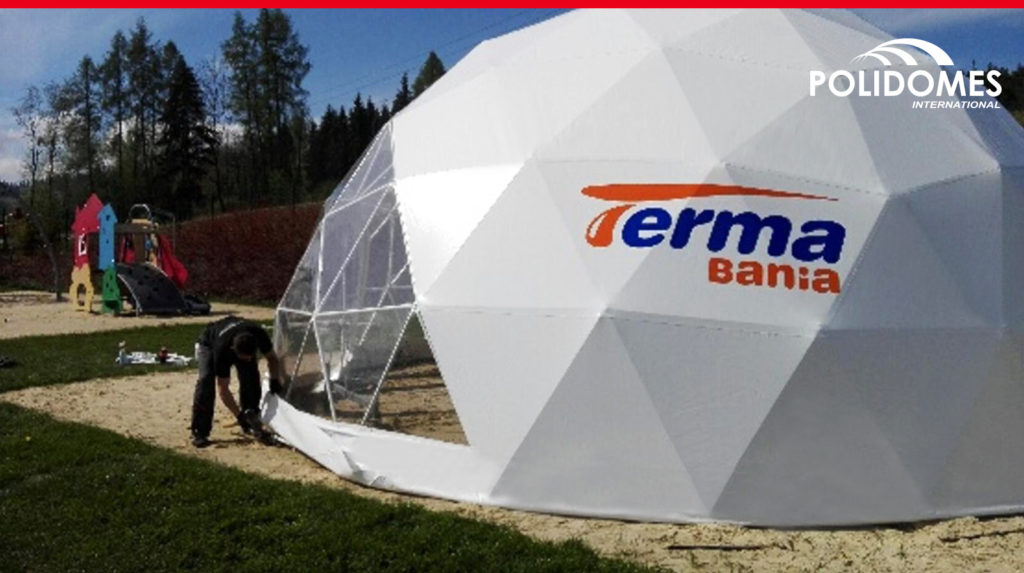 commercial tent half-transparent with logo standing on the send